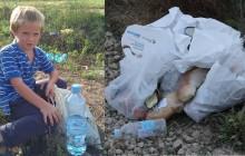 Węgierski chłopiec zbiera jedzenie wyrzucone przez imigrantów
